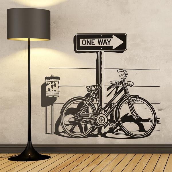 Vinilos Decorativos: Bicicleta sobre señal de tráfico One Way