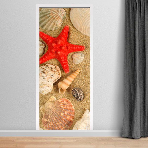Vinilos Decorativos: Puerta motivos marinos en la arena