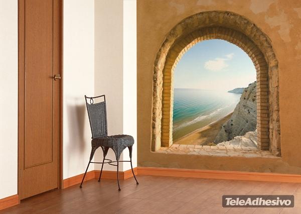 Un fotomural de una ventana con vistas a la playa puede formar parte de tus ideas de decoración